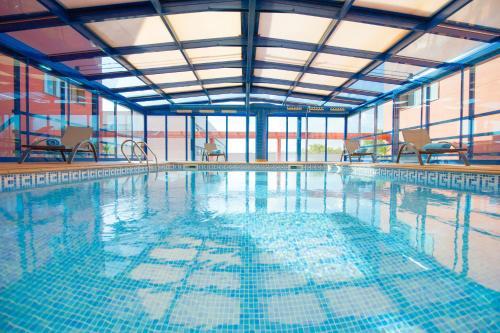The swimming pool at or near Ciutat del Prat