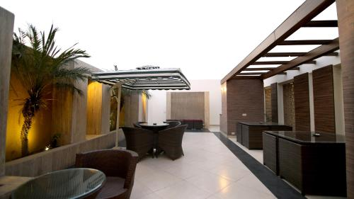 A balcony or terrace at The Prime Balaji Deluxe @ New Delhi Railway Station