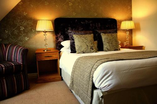 A bed or beds in a room at The Bridge Hotel and Spa