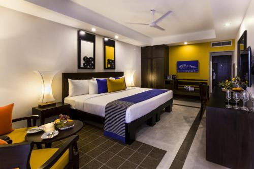 A bed or beds in a room at Club Hotel Dolphin