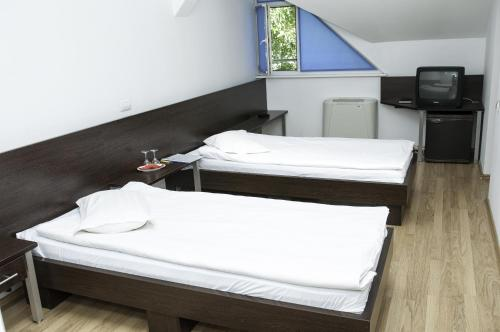 A bed or beds in a room at Villa Grande