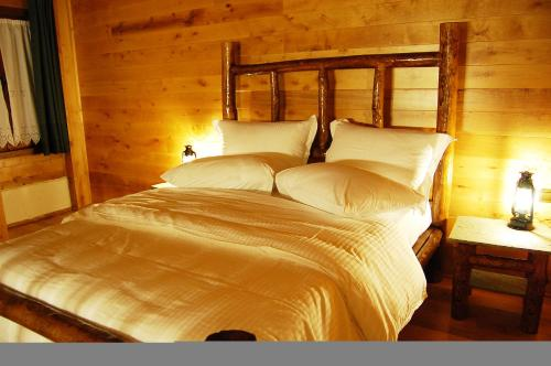 A bed or beds in a room at Vogdos Resort