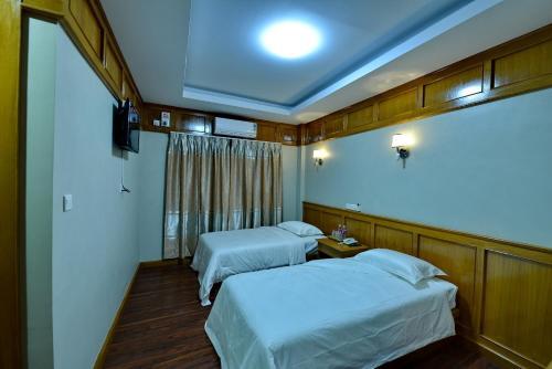 Ein Bett oder Betten in einem Zimmer der Unterkunft Innwa Motel