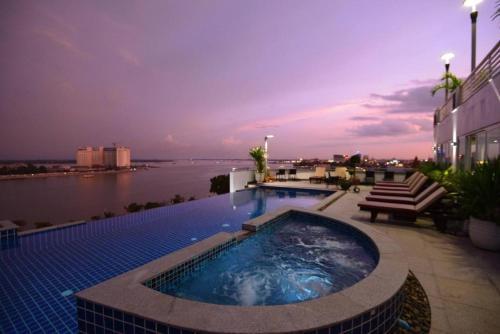 The swimming pool at or near Harmony Phnom Penh Hotel