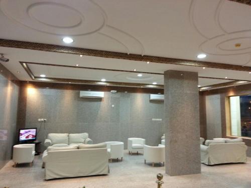 Um restaurante ou outro lugar para comer em Qemmat Al Rafaa