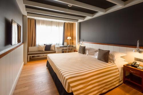 A bed or beds in a room at U232 Hotel