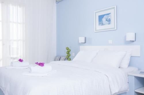 Un ou plusieurs lits dans un hébergement de l'établissement Paradise Resort