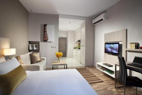 A television and/or entertainment centre at Citadines Uplands Kuching