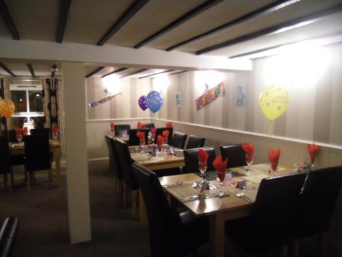 A restaurant or other place to eat at Plough Inn