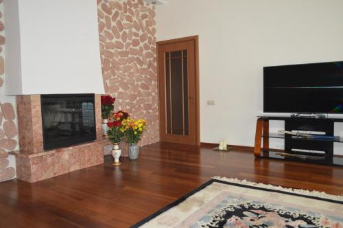 A television and/or entertainment center at Homestay on Shmitovsky Proyezd