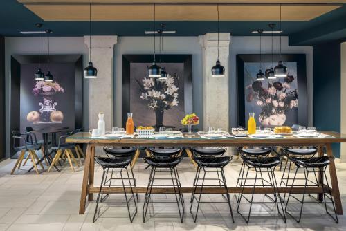 Restaurant ou autre lieu de restauration dans l'établissement Okko Hotels Lyon Pont Lafayette