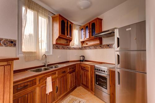 A kitchen or kitchenette at Aissatou Beach Resort