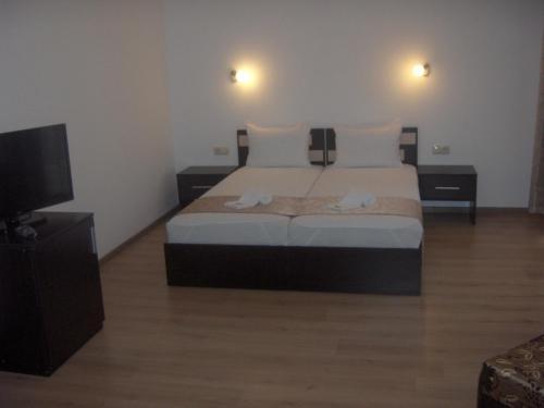 Кровать или кровати в номере Krasteva House
