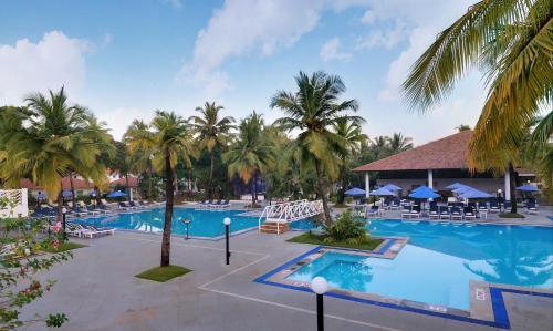 The swimming pool at or near Novotel Goa Dona Sylvia Resort