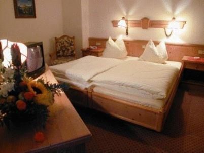 Ein Bett oder Betten in einem Zimmer der Unterkunft Hotel Restaurant Hassia
