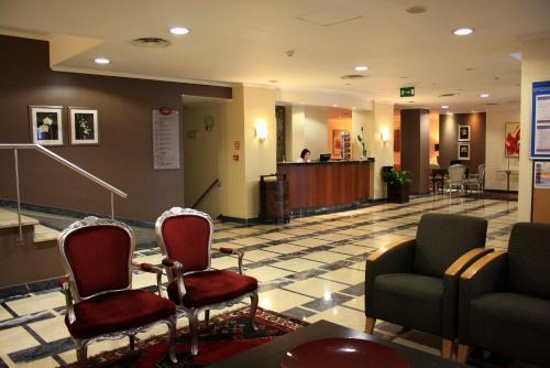 The lobby or reception area at Hotel Orquidea