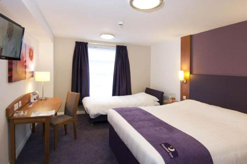 A bed or beds in a room at Premier Inn London Gatwick Airport - A23 Airport Way