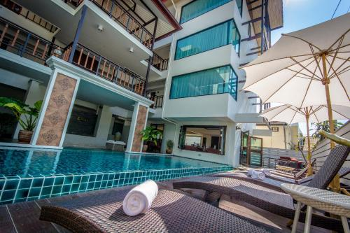 The swimming pool at or near Goldenbell Hotel Chiangmai