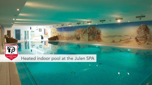 The swimming pool at or near Tradition Julen Hotel