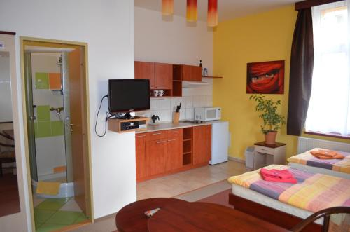 Кухня или мини-кухня в Residence Salvia