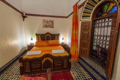 Ein Bett oder Betten in einem Zimmer der Unterkunft Riad Meski