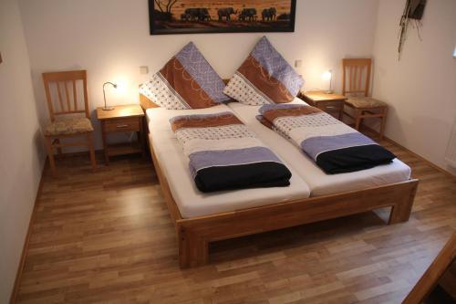 Ein Bett oder Betten in einem Zimmer der Unterkunft Ferienwohnung Graf