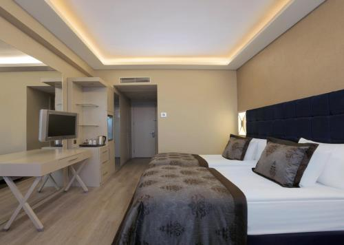 A bed or beds in a room at WOW Istanbul Hotel