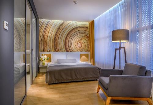 A bed or beds in a room at TAV Airport Hotel Izmir