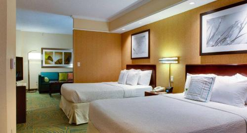 A bed or beds in a room at SpringHill Suites Savannah Airport