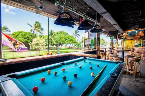 A pool table at Castle Waikiki Grand Hotel