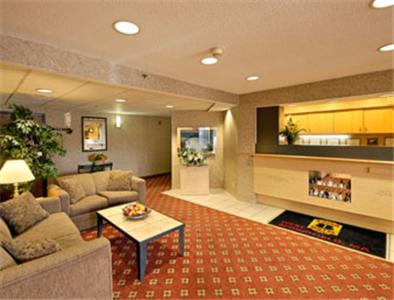 The lobby or reception area at Super 8 by Wyndham West Springfield/Route 5