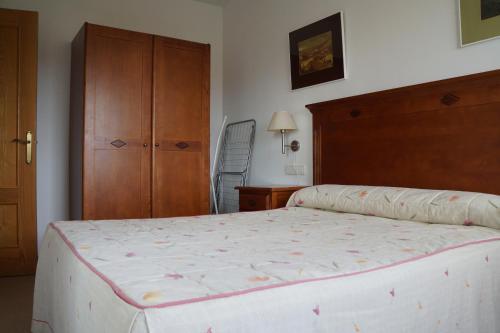 Cama o camas de una habitación en Apartamentos Proamar