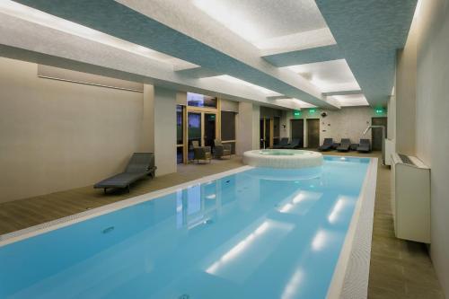 Het zwembad bij of vlak bij Amberton Green Apartments Palanga