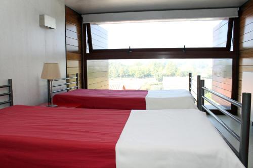 A bed or beds in a room at HI Ponte de Lima - Pousada de Juventude