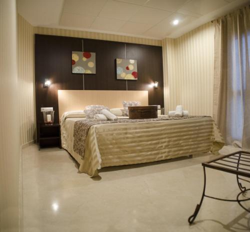 Ein Bett oder Betten in einem Zimmer der Unterkunft Hotel Duquesa