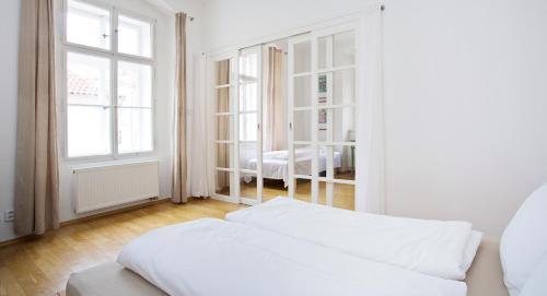 Кровать или кровати в номере Apartment U hroznu