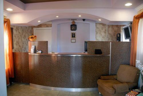 The lobby or reception area at Ambassador Inn Fresno