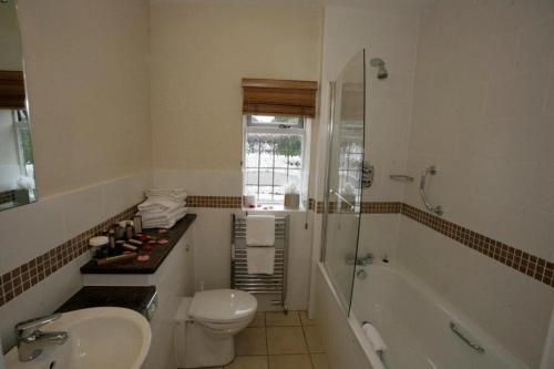 A bathroom at Cisswood House