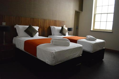 A bed or beds in a room at The Inn Place