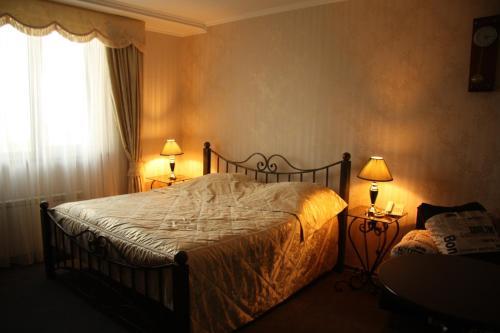Кровать или кровати в номере Гостиница Плаза