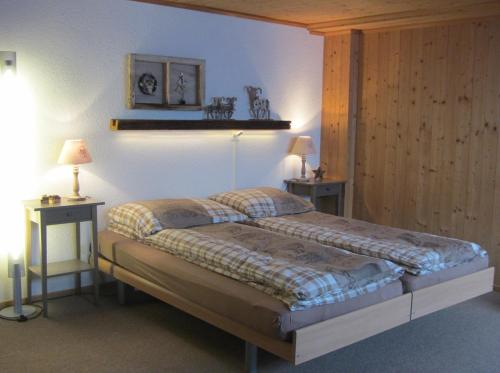 A bed or beds in a room at Pension Staldacher