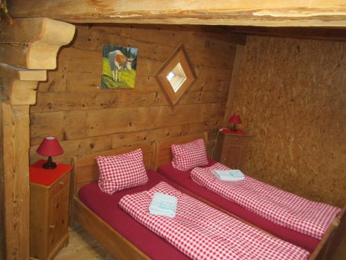 A bed or beds in a room at Bauernhotel Gässlihof