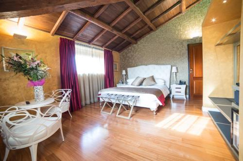 A bed or beds in a room at Cola di Rienzo Luxury Penthouse