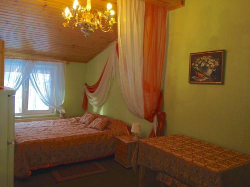 A bed or beds in a room at Cottage Resort Spas Kamenka