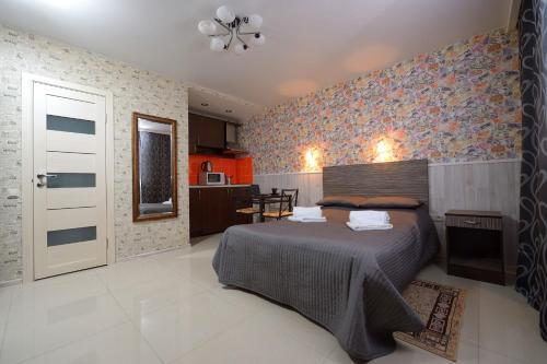Кровать или кровати в номере LeoHotels Знаменская