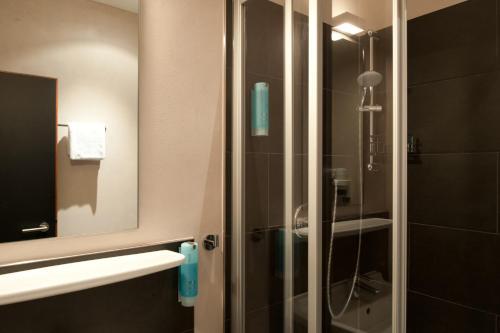 Een badkamer bij Hotel Topas