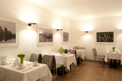 Een restaurant of ander eetgelegenheid bij Hotel Topas