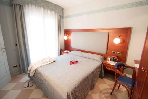 Letto o letti in una camera di Hotel Costazzurra