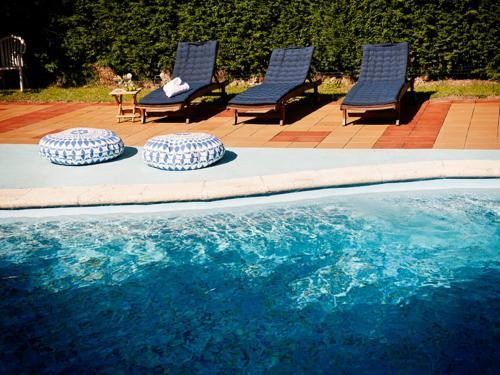 The swimming pool at or near Posada Santa Ana