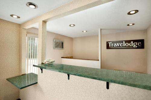The lobby or reception area at Travelodge by Wyndham La Porte/Michigan City Area